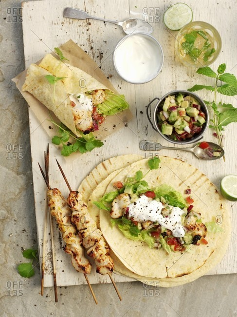 Chicken wraps with avocado salsa and sour cream