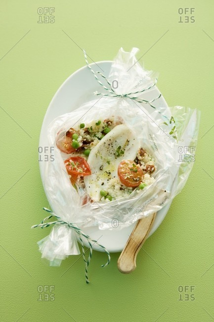 Steamed fish with tomatoes and couscous