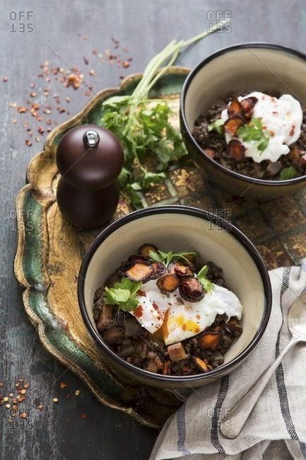 Lentil stew with poached egg and parsley