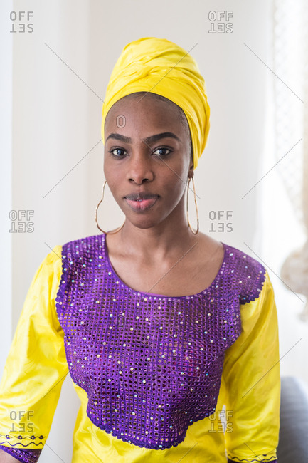 Portrait of a mid adult black woman outdoors wearing traditional clothing and looking at camera
