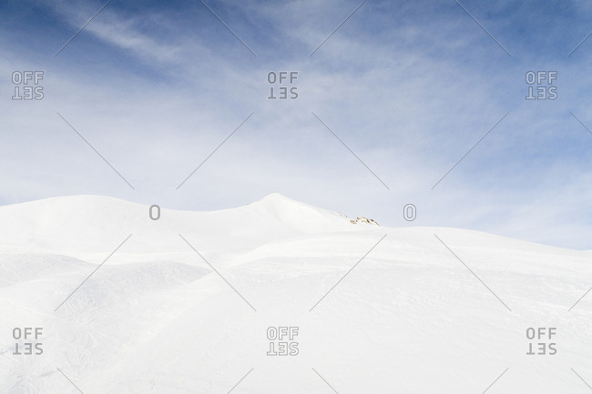 Snow covered mountain with a bright blue sky
