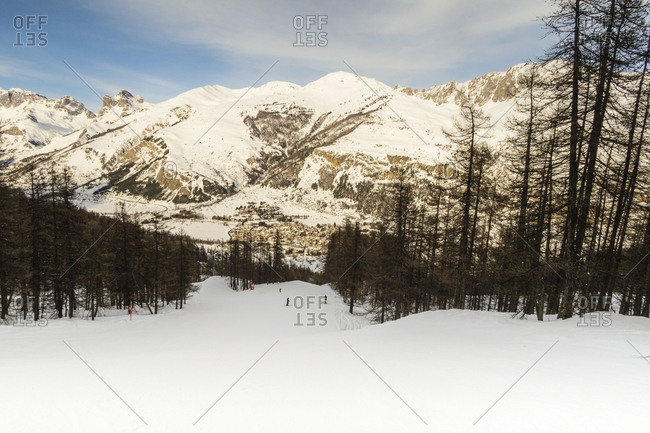 Skiers on a snowy mountains in the Alps