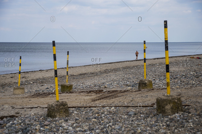 A woman at the shore of the Ostsee at Hohenfelde, Germany.
