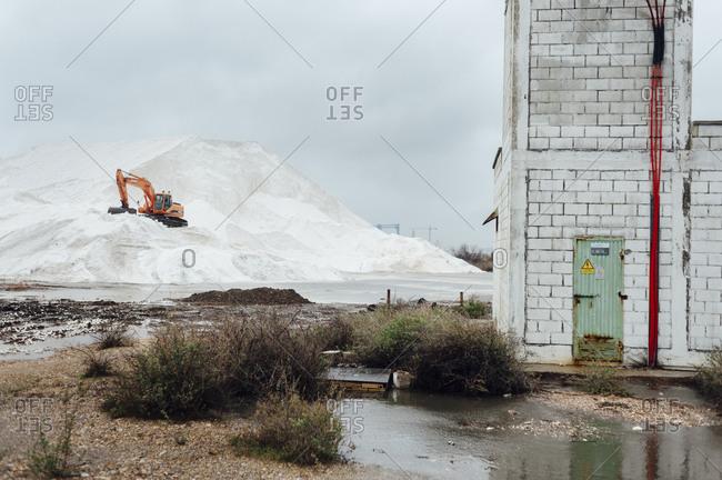Huelva, Spain - February 9, 2014: Crane working in the salt flats