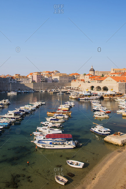 Dubrovnik, Croatia - July 19, 2017: Boats in the old town harbour