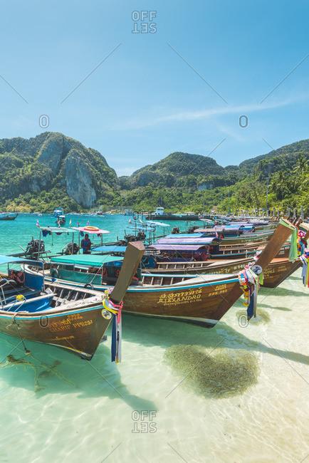 Ko Phi Phi Don, Krabi Province, Thailand - March 22, 2018: Ao Ton Sai Beach, Traditional longtail boats on the beach