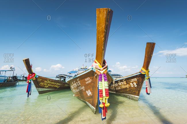 Ko Phi Phi Don, Krabi Province, Thailand - March 22, 2018: Ao Lo Bakao (Lo Bakao Bay), traditional longtail boats on the beach
