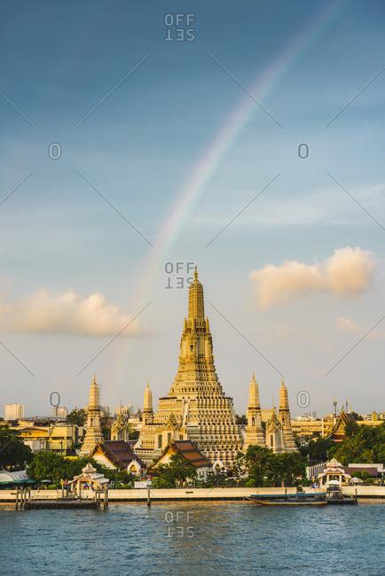 Rainbow over Wat Arun (Temple of Dawn) and Chao Praya River, Bangkok, Thailand