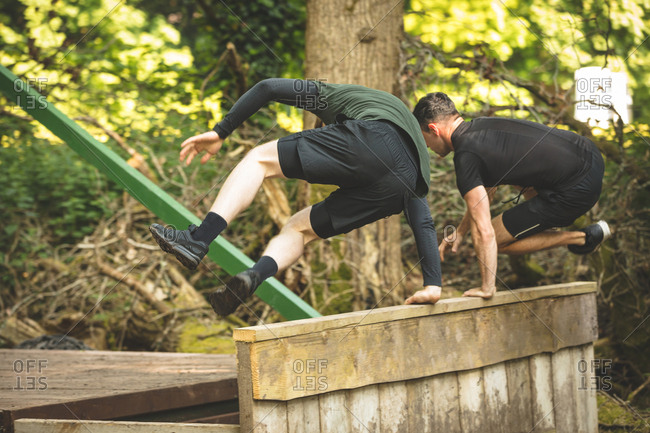 Two men exercising on obstacle course at boot camp