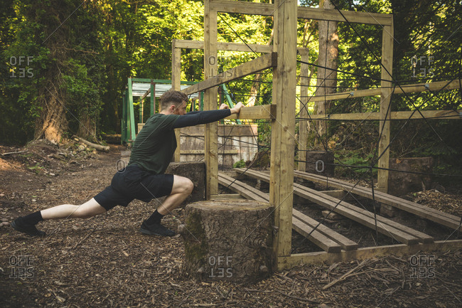 Fit man exercising at boot camp on a sunny day