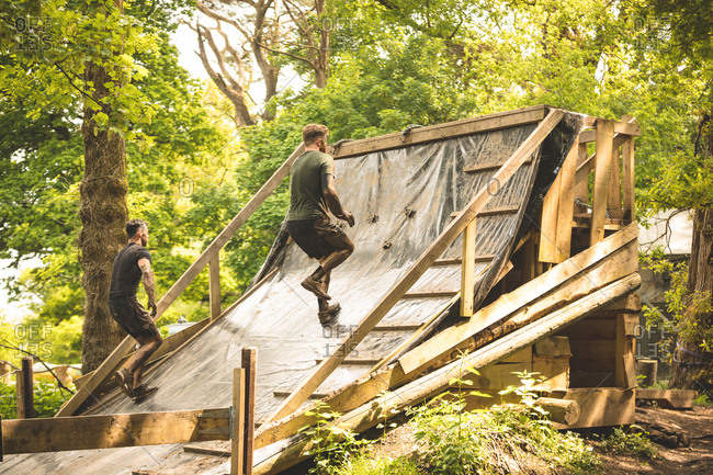 Fit men training over obstacle course at boot camp