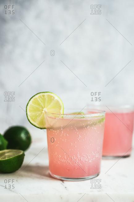 Pink lemonade with lime garnish