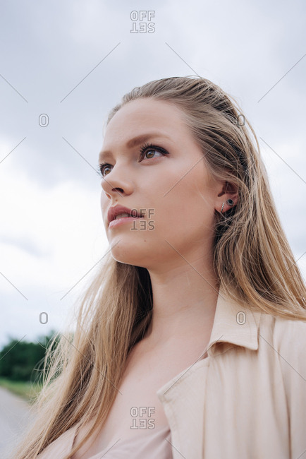 Portrait of young blonde woman outdoors