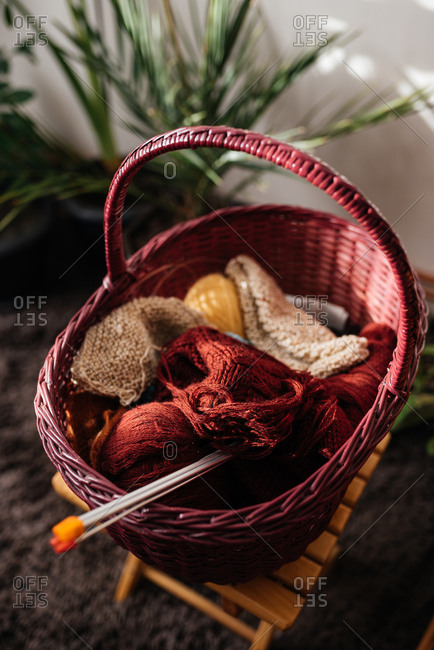 Knitting basket with knitting needles