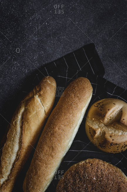 Assortment of fresh and golden breads, flat lay, from above