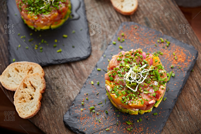 Top view of salmon tartar with bread and decoration