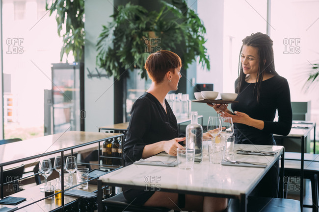 Young woman ordering food in a restaurant