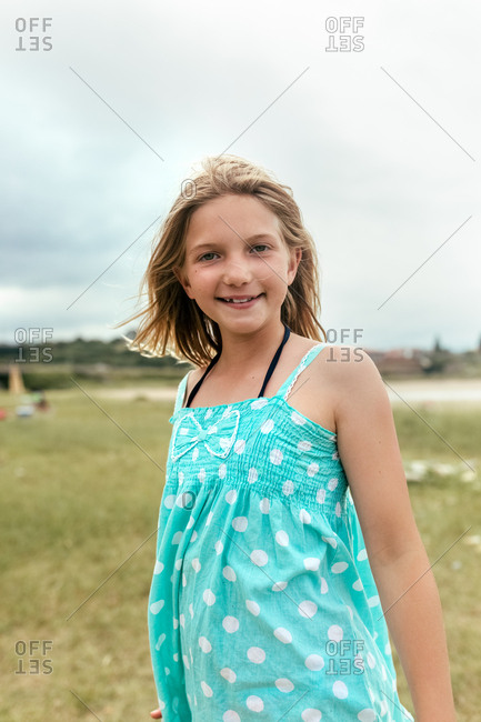 Portrait of a little girl on the beach