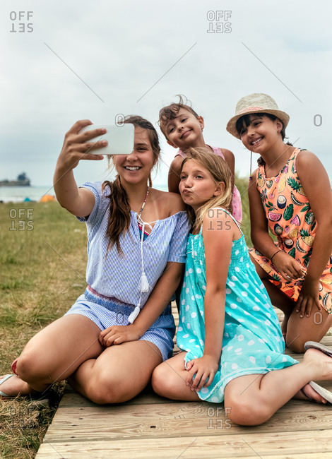 Four little friends making a selfie on the beach