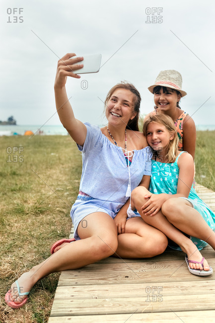 Three little friends making a selfie on the beach