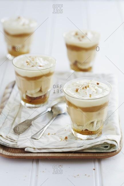 Layered deserts with caramel cream, bananas and creamy yoghurt
