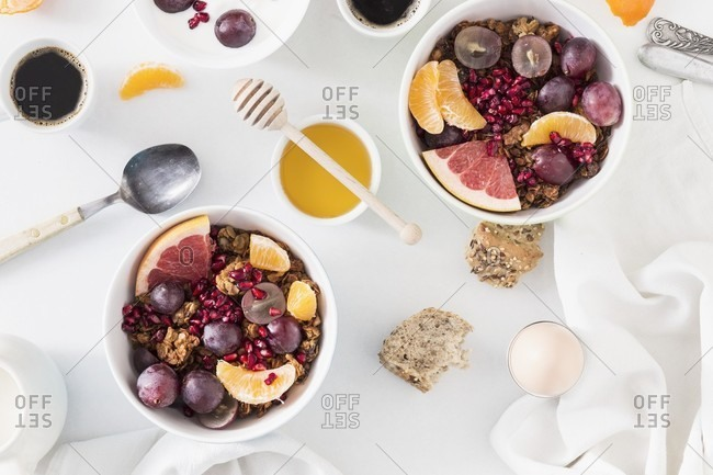 Breakfast with muesli, fruit, honey, eggs and coffee
