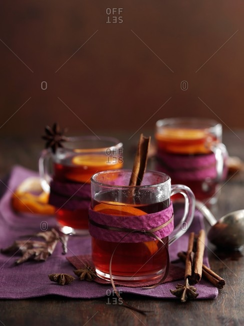 Glasses of mulled wine with cinnamon, anise and orange slices