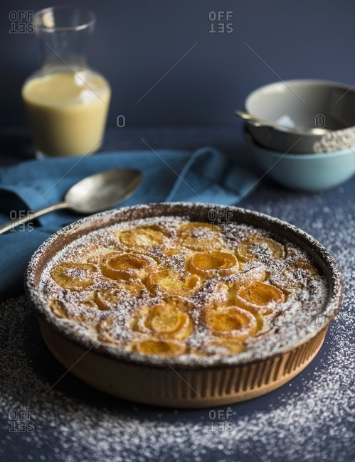 Calfoutis with apricots and icing sugar