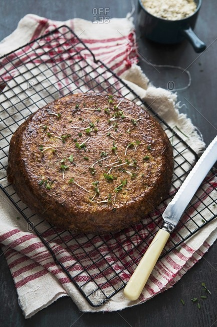 Spicy cauliflower cake with cress on a cooling rack