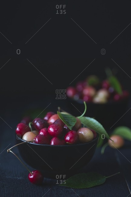 Fresh cherries in a black bowls