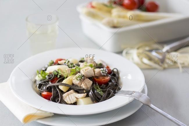 Black tagliatelle with asparagus and zander