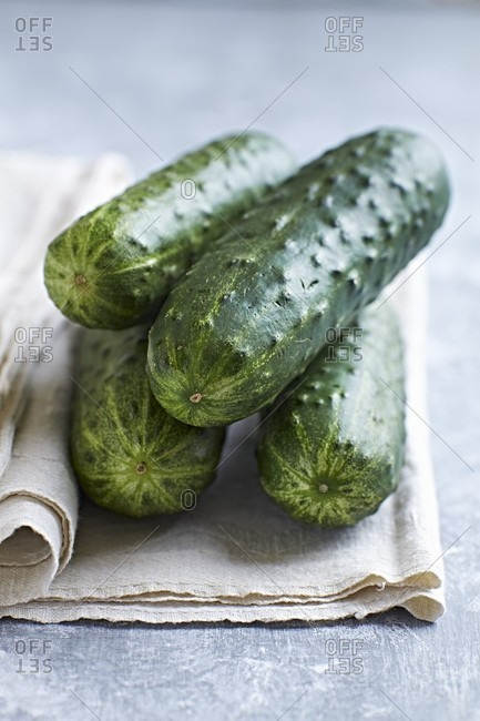 Fresh cucumbers on a linen cloth