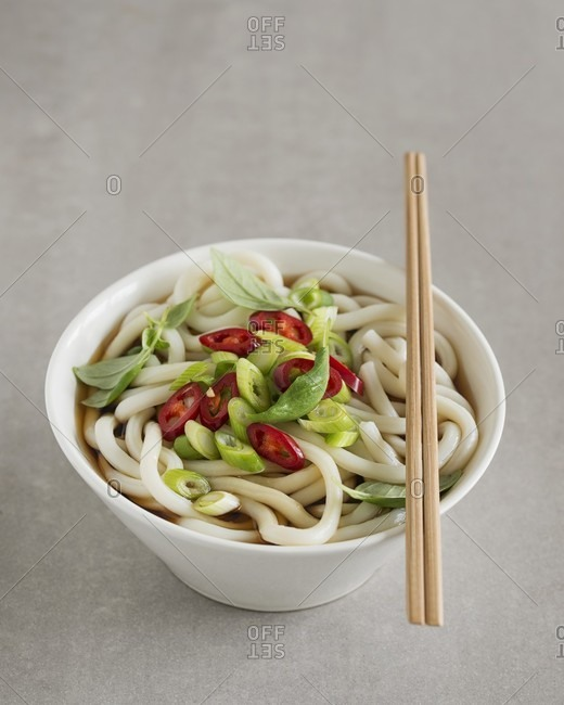 Udon noodle soup with spring onions and chilli rings (Japan)