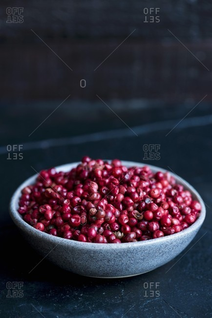 A bowl of pink peppercorns