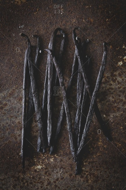 Vanilla pods on a rusty surface