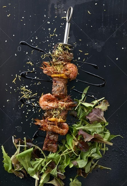 Beef and prawns skewers with salad