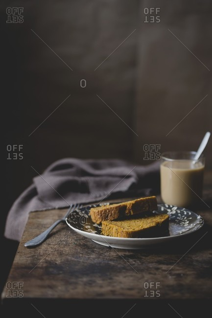 Two slices of carrot cake on a plate