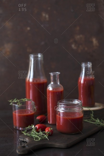 Sieved tomatoes in jars and bottles