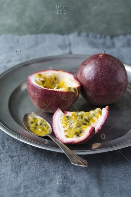 Passion fruits on a pewter plate