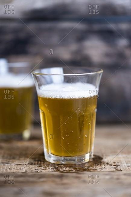Two glasses of light beer