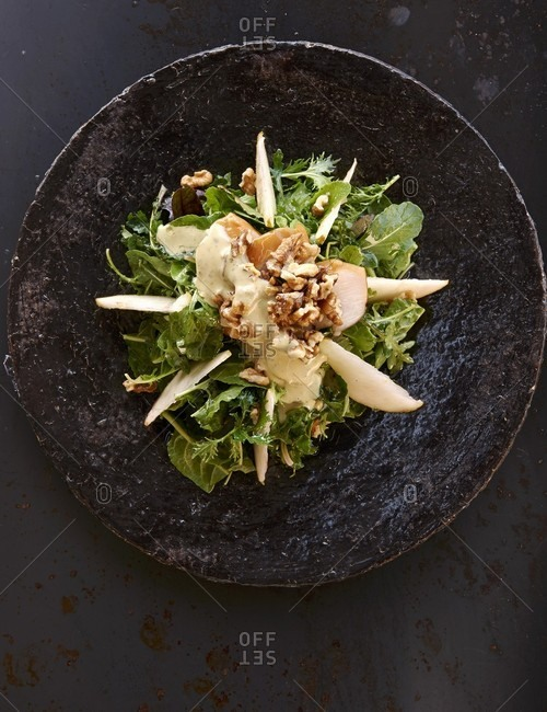 An autumnal salad with pears and walnuts
