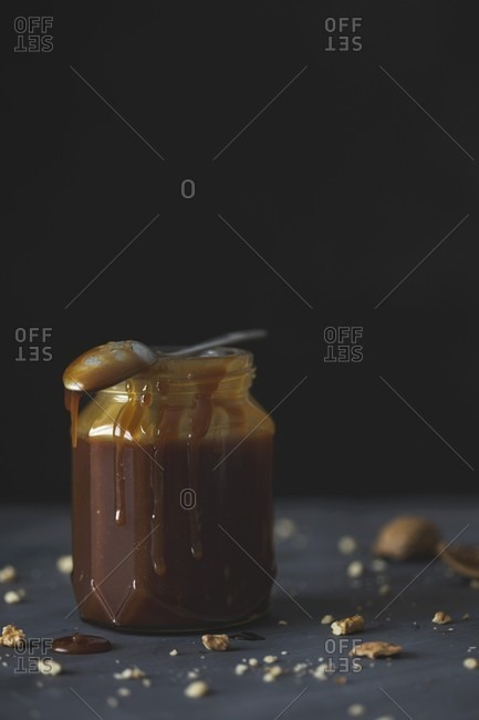 A jar of dark caramel sauce