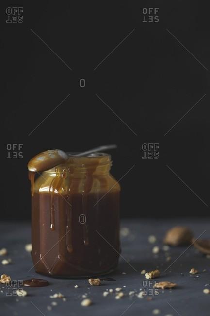 A jar of dark caramel sauce