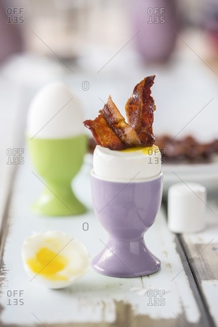 A soft boiled egg and bacon for an Easter breakfast