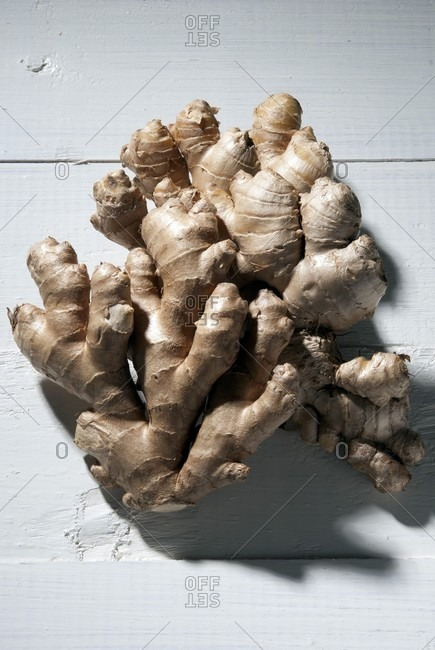 Organic ginger root on a white surface