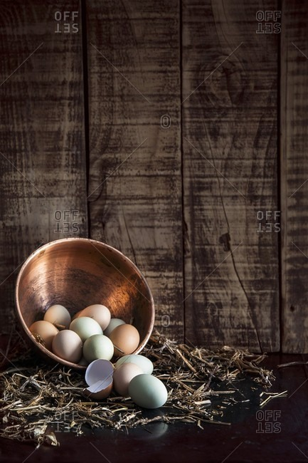 Free range eggs in copper bowl on straw