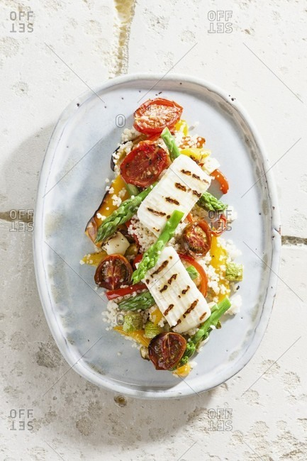 Couscous salad with antipasti and grilled haloumi