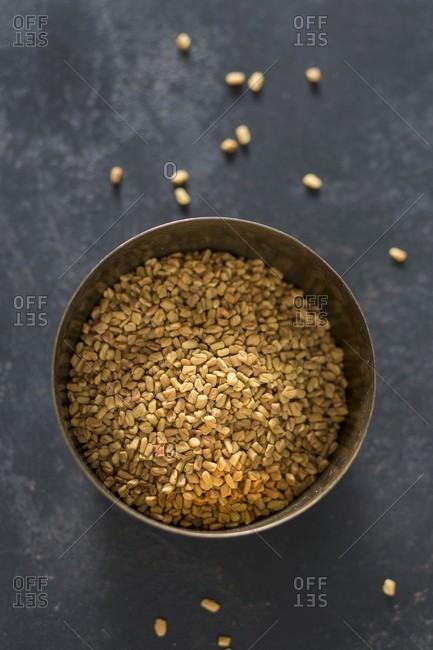 Fenugreek seeds in a metal bowl