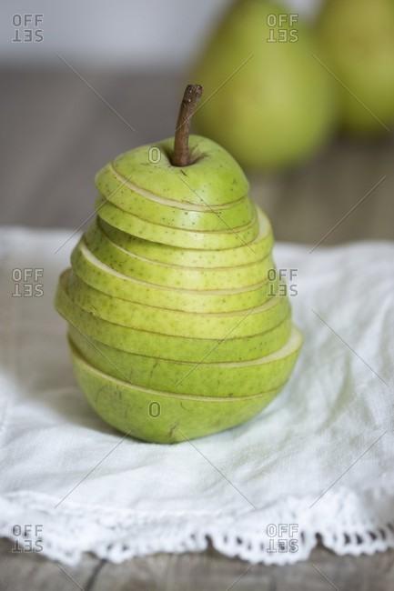 A sliced pear on cloth