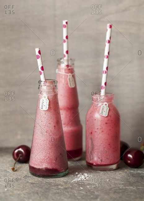 Half-drunk cherry and coconut smoothies